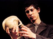 "British stage actor as the lead in Trevor Nunn's 2004 production of Hamlet at the Old Vic in London. Here Hamlet contemplates the skull of Yorick in the famed ""Gravedigger Scene."""